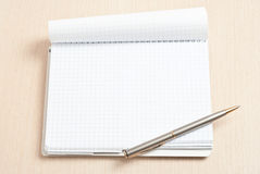 Blank spiral note pad and pen Stock Images