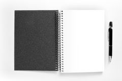 Blank spiral note pad and pen on white background. Royalty Free Stock Photos