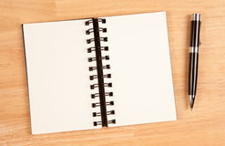 Blank Spiral Note Pad and Pen on Wood. Background Stock Photo