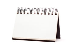 Blank Spiral Note Pad Standing on White. Blank Spiral Note Pad Standing Isolated on a White Background Stock Photo
