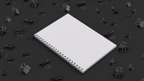Blank spiral notebook with black binder clips on black table. Business, education or office mockup. 3D rendering illustration Royalty Free Stock Photos