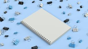 Blank spiral notebook with black, white and blue binder clips on blue table. Business, education or office mockup. 3D rendering illustration Stock Image