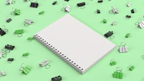 Blank spiral notebook with black, white and green binder clips o. N green table. Business, education or office mockup. 3D rendering illustration Royalty Free Stock Photo