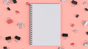 Blank spiral notebook with black, white and red binder clips on. Red table. Business, education or office mockup. 3D rendering illustration Royalty Free Stock Photo