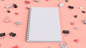 Blank spiral notebook with black, white and red binder clips on. Red table. Business, education or office mockup. 3D rendering illustration Stock Photos