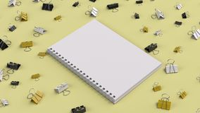 Blank spiral notebook with black, white and yellow binder clips. On yellow table. Business, education or office mockup. 3D rendering illustration Royalty Free Stock Images