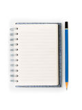 Blank spiral notebook and blue pencil isolated Stock Image