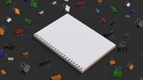 Blank spiral notebook with colorful binder clips on black table. Business, education or office mockup. 3D rendering illustration Royalty Free Stock Images