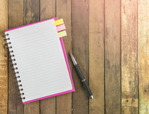 Blank spiral notebook and pen on wood Stock Photo