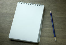 Blank spiral notebook and pencil Stock Image