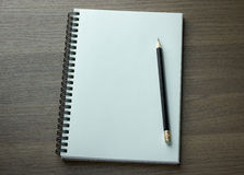 Blank spiral notebook and pencil Stock Images