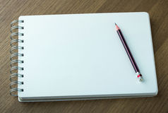Blank spiral notebook and pencil Stock Photo