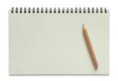 Blank spiral notebook and pencil Stock Photos
