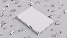 Blank spiral notebook with white binder clips on white table. Business, education or office mockup. 3D rendering illustration Stock Image