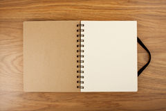 Blank Spiral Notebook on a wooden Background with clipping path. Royalty Free Stock Images