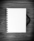 Blank Spiral Notebook on a wooden Background with clipping path. Stock Image