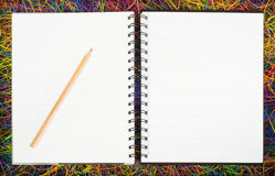 Blank spiral notebooks on electric wire. Stock Photography