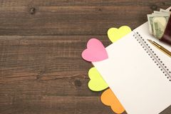 Blank Spiral Notepad Page,  Hearts, Wallet On Wood Table Backgro Stock Photography