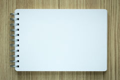 Blank spiral notepad on wood background Stock Image