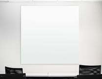 Blank square board on the white wall Stock Photo