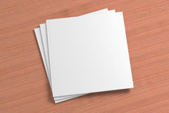 Blank square Magazine on the wooden Background Royalty Free Stock Photo