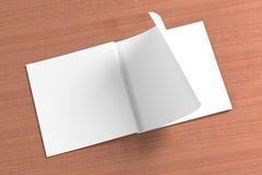 Blank square Magazine on the wooden Background. For your design stock image