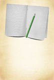 Blank squared exercise book and pencil Royalty Free Stock Photography