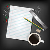 A blank stack of paper, a pencil and a coffee cup over a desk Stock Photo
