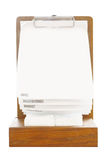 Blank standing menu with white paper on wooden stand Stock Images