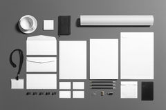 Blank stationery branding set isolated on grey. Consist of document, note, business cards, pencil, money clips, envelopes Royalty Free Stock Photo