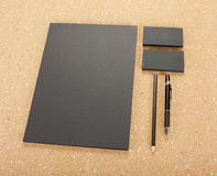 Blank Stationery on cork board. Consist of Business cards, A4 letterheads, pen and pencil. Royalty Free Stock Image
