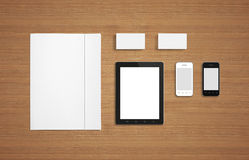 Blank Stationery / Corporate ID set. Blank Stationery Corporate ID Template on wooden background. Consist of Business cards, Folder, Tablet PC, envelopes and Royalty Free Stock Image