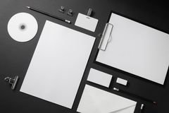 Blank stationery set. On black background. Corporate identity template. Mock-up for branding identity. Top view Stock Photos