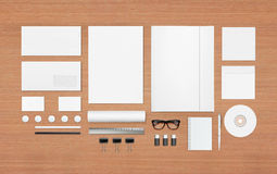 Blank Stationery Set. Blank Stationery Corporate ID set on wooden background with soft shadows. Consist of Business cards, A4 letterheads, Folder, Tablet PC Royalty Free Stock Image