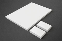 Blank Stationery Set. Blank Stationery on dark background with soft shadows. Consist of Business cards and A4 letterheads Stock Photos