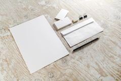 Blank stationery. Set on light wooden background. For design presentations and portfolios. Top view Stock Photos