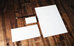 Blank stationery set. On vintage wooden table background. Photo of blank letterhead, business cards, envelope and pencil Royalty Free Stock Images