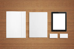 Blank Stationery set on wooden background. Blank Stationery set on wooden background with soft shadows. Consist of Business cards, A4 letterheads, Folder Royalty Free Stock Photos