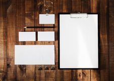 Blank stationery set. On wooden table background. Letterhead, business cards, badge, envelope and pencil. Top view Stock Image