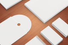Blank Stationery on wooden background close view. Consist of Business cards, A4 letterheads, note, cd disk and notebook Royalty Free Stock Photos