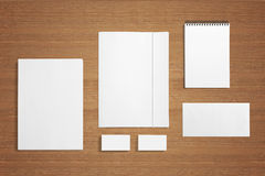 Blank Stationery on wooden background. Blank Stationery background. Consist of Business cards, Folder, envelopes, letterhead a4 and notes Stock Photo