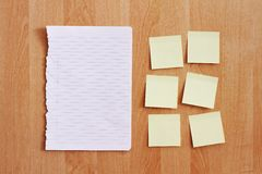 Blank stationery on wooden wall Stock Image