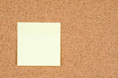 Blank stick note on bulletin board texture or background Royalty Free Stock Images