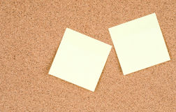 Blank stick notes on bulletin board texture or background Royalty Free Stock Images