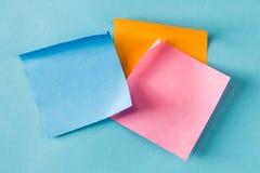 Blank sticky note. On a blue background Stock Photo