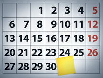 Blank sticky note on a calendar. Close up of a blank sticky note on a calendar post it on the 31st day royalty free stock image