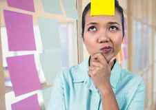 Blank sticky note on female executive forehead. In office Royalty Free Stock Photos