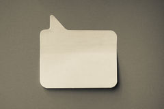 Blank sticky note on grey wall, copy space for a message. Stock Images