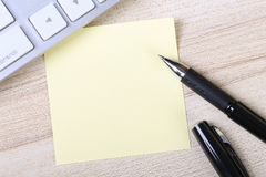 Blank Sticky Note With Keyboard Royalty Free Stock Photography