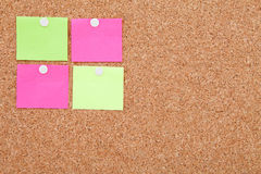 Blank sticky notes pinned on cork memo board Stock Photography